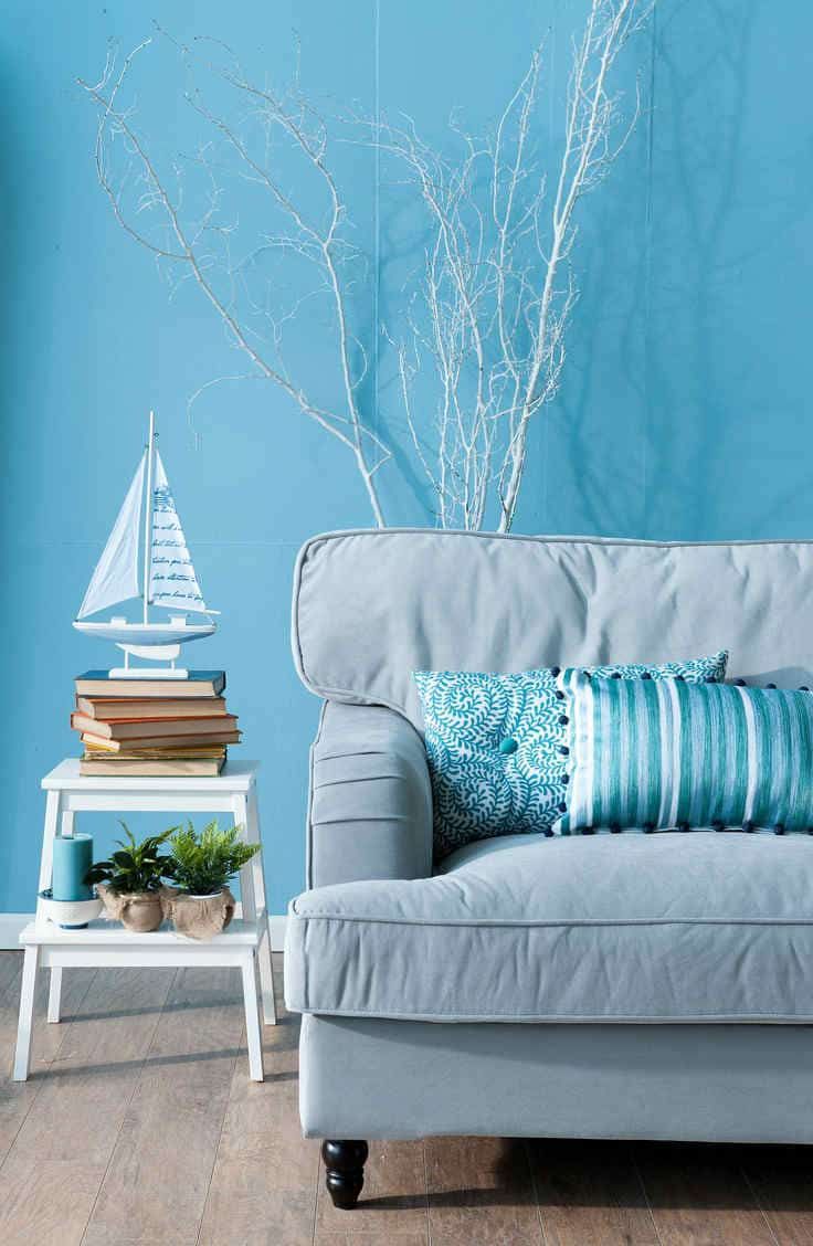 Blue living room with beach theme.