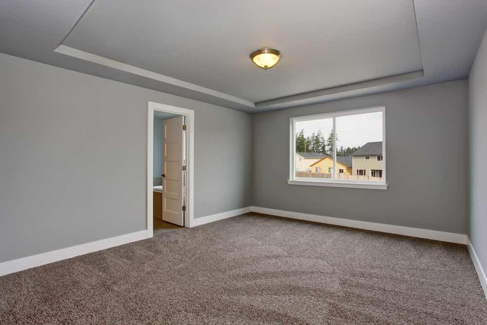 Grey Basement Room With Painted Trim