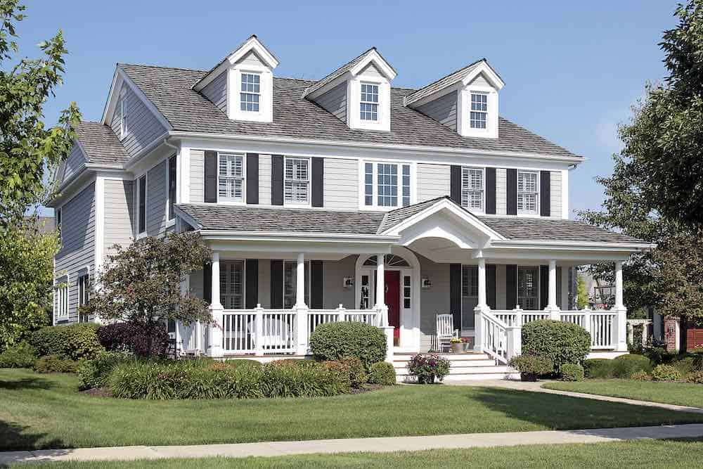Tan house black shutters