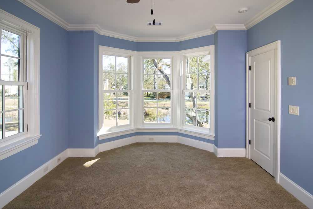Blue Sunroom With Painted Trim
