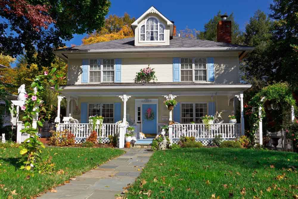 Tan House Blue Shutters