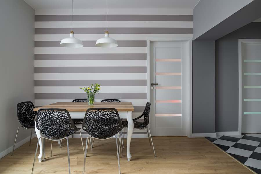 Striped wall in a dining room.