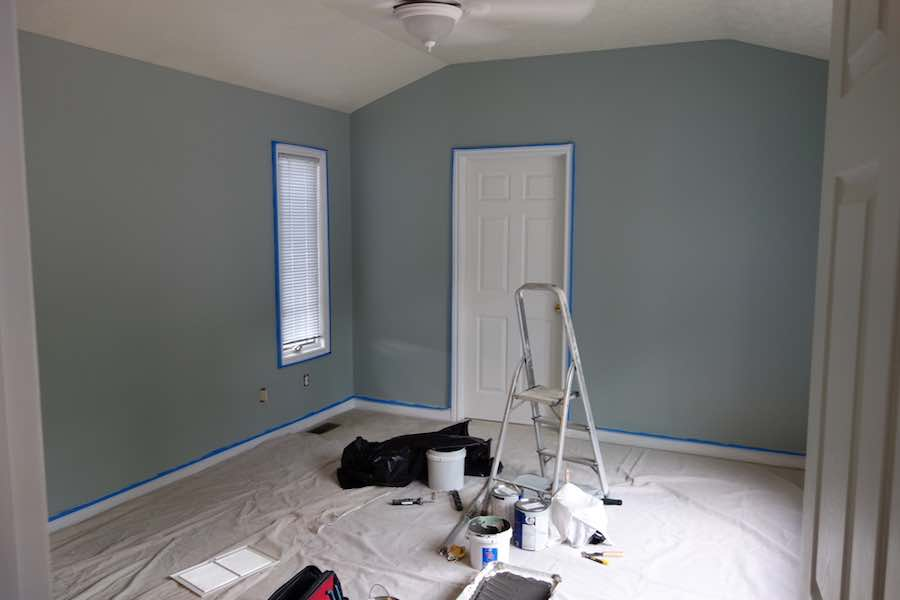 Trim of a room taped off using painter's tape.