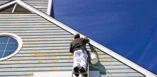 Exterior Painting Contractor on a Ladder
