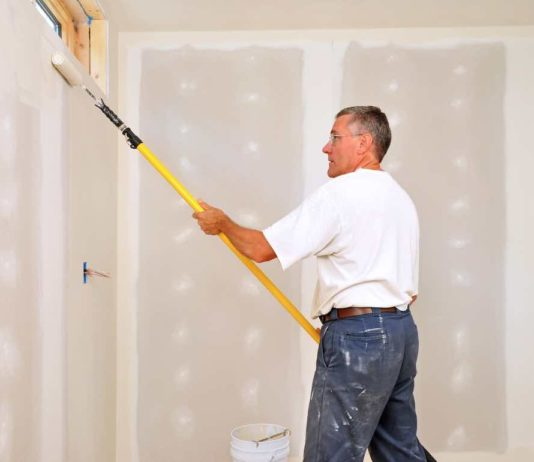 Painting a room with a Paint Roller Extension Pole