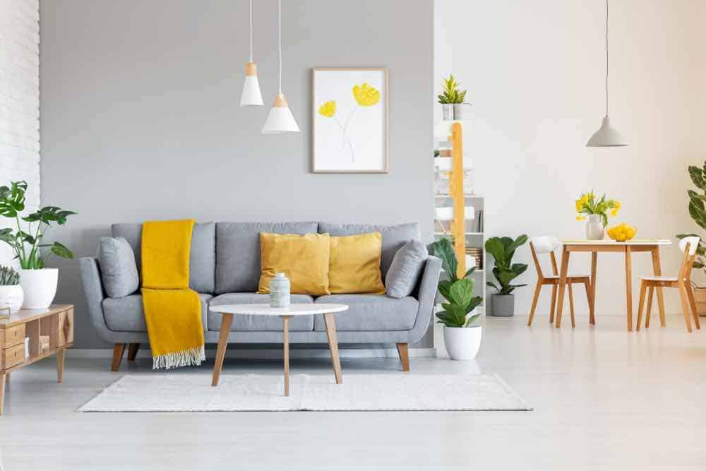 Grey Sofa with Orange Accent Pillows