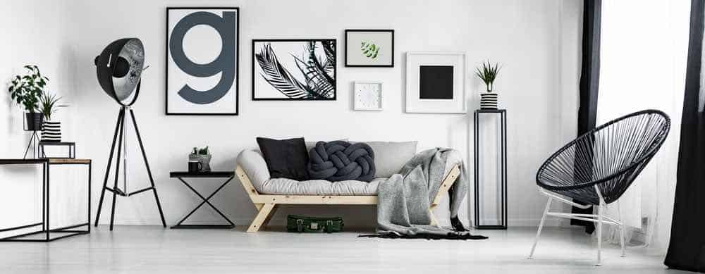 White Living Room With Black Accent Pillows and Art