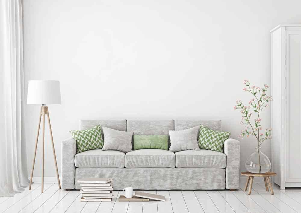 White living room with light grey sofa