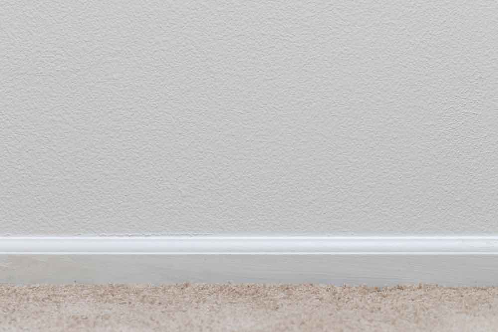 White Trim Painted On Carpet