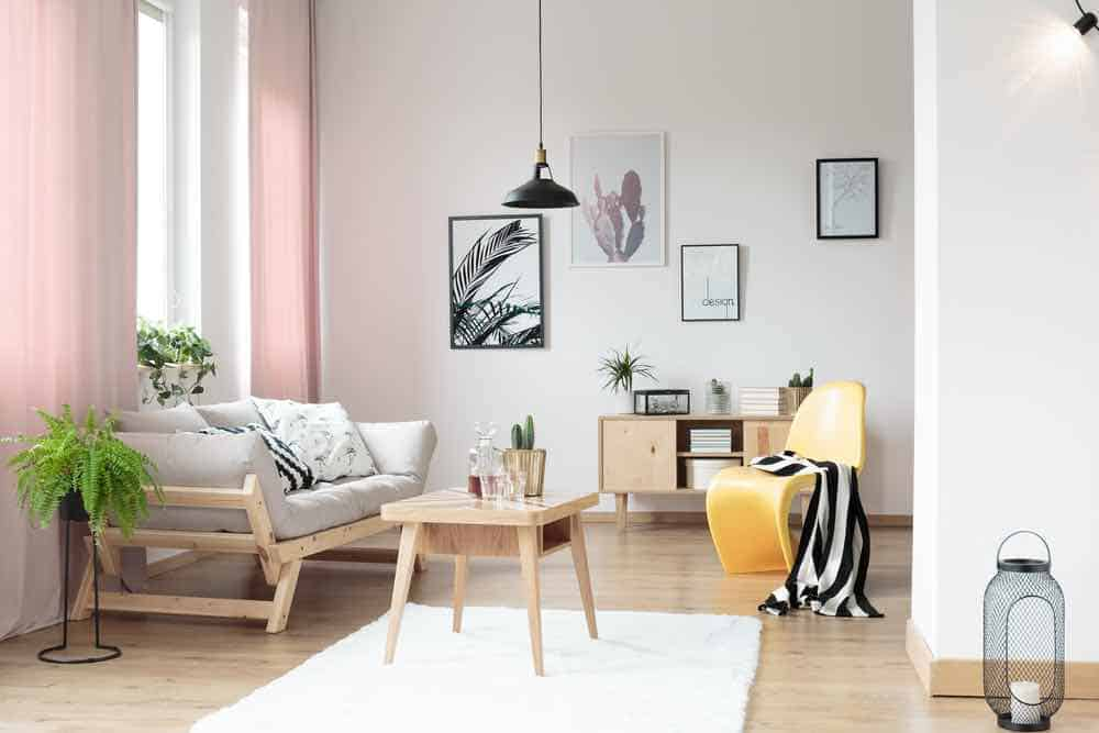 White living room with pink pastel curtains