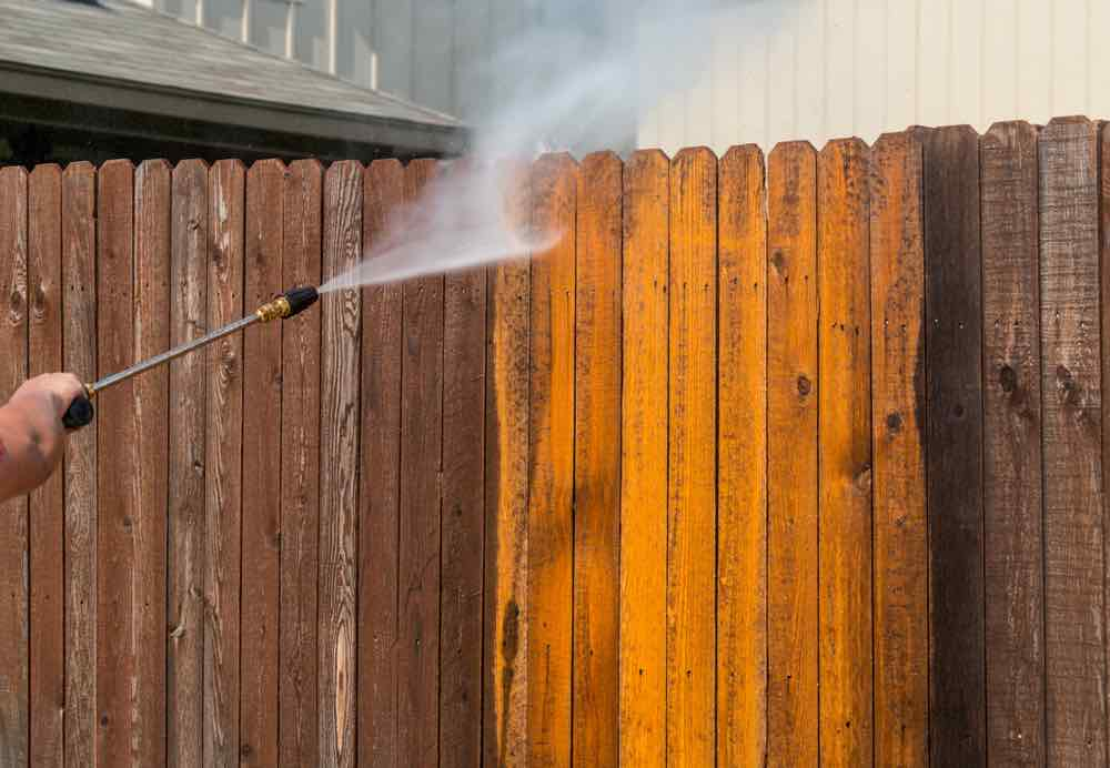 Power washing a fence