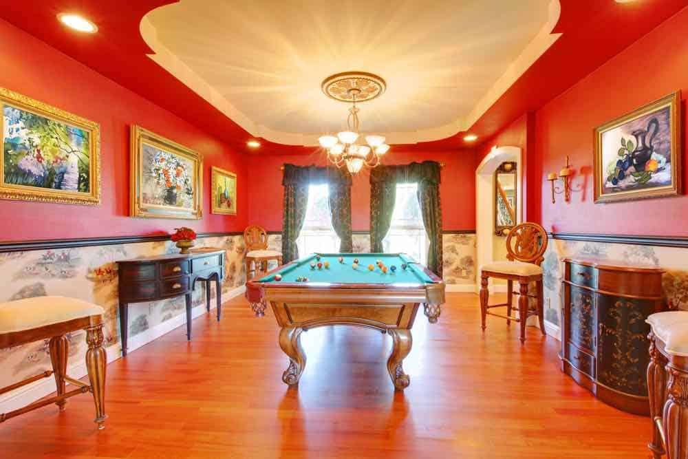 Red game room with billard table