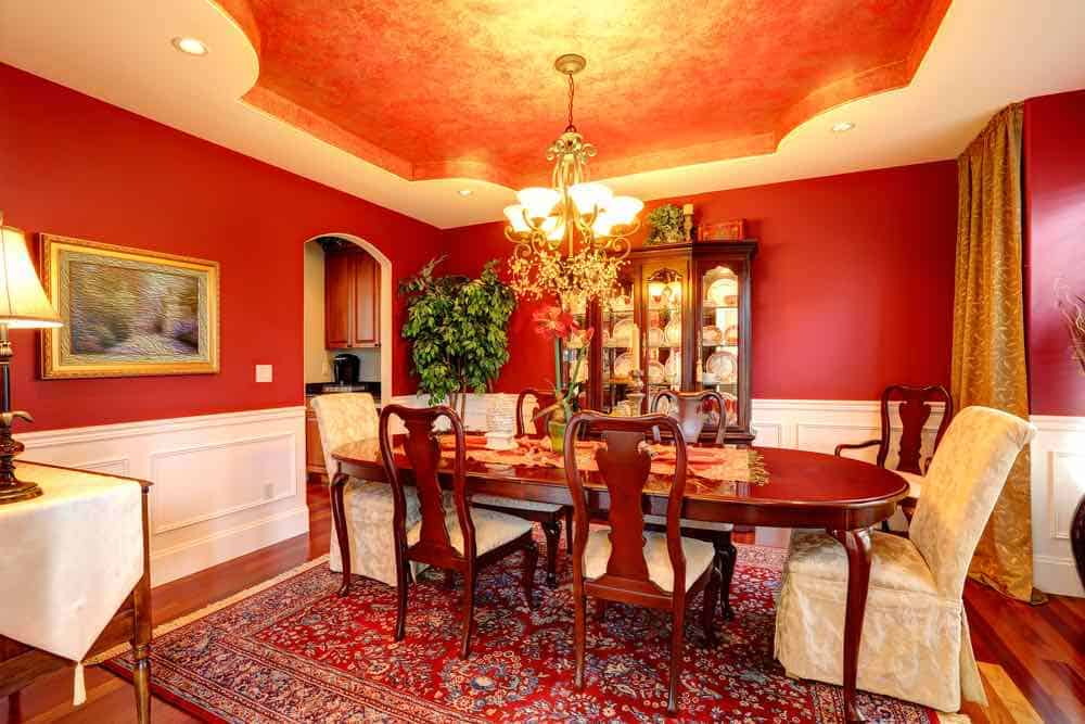 Red walls white trim dining room