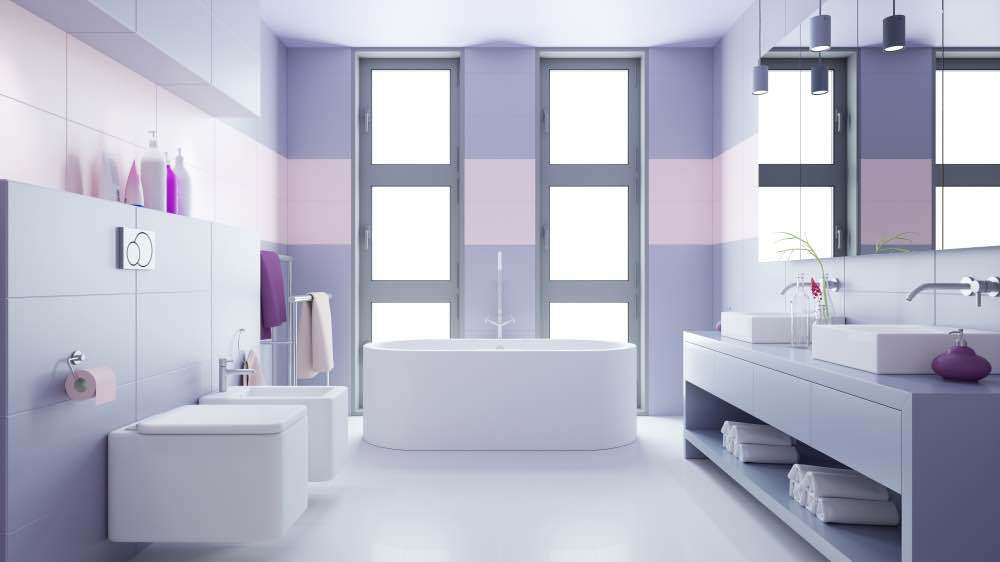 A sleek urban bathroom with purple walls and a stripe of pale pink around the room.
