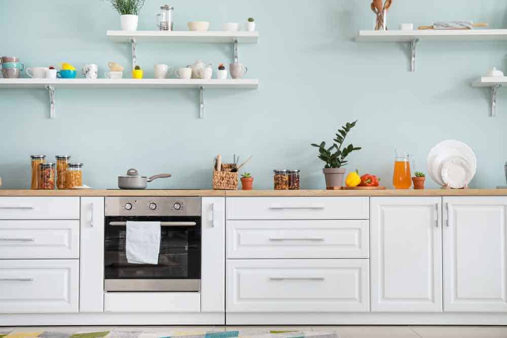 Pale kitchen paint colors let the light shine in the space.