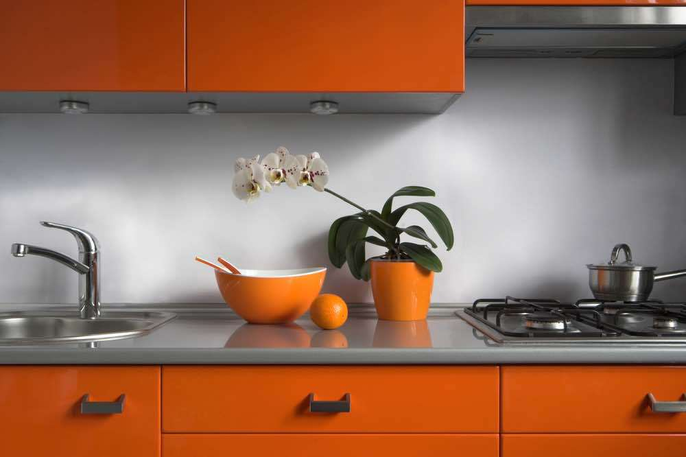 Tame kitchen paint color gets a wild treatment with the cabinet color.