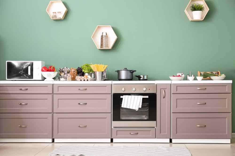Matching cabinet color with kitchen paint color can be hard, but it's always worth the extra effort.