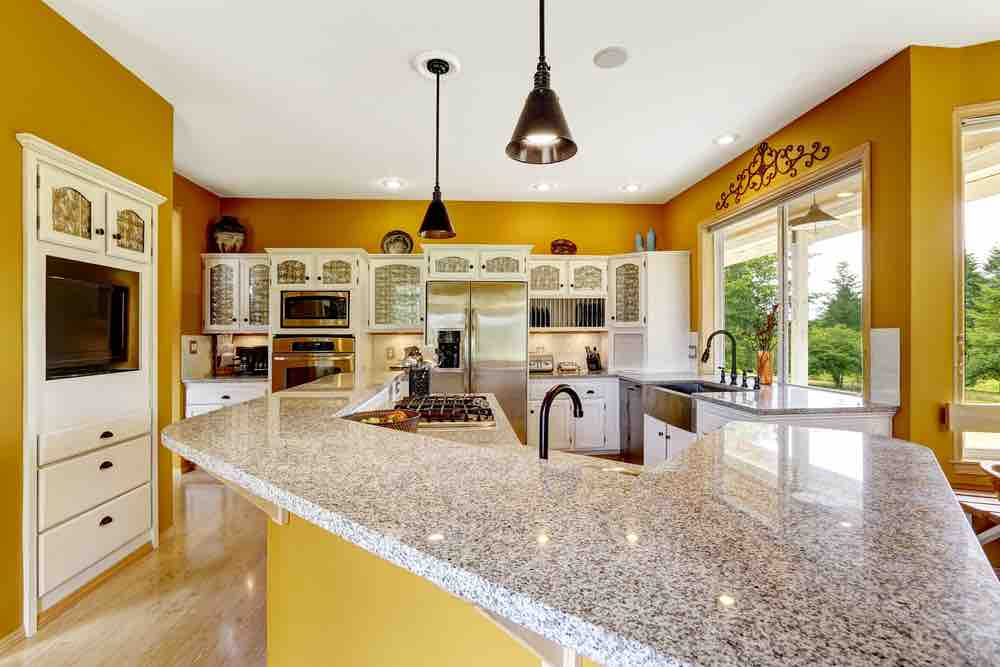 Unusual paint colors are some of our favorites, like rich gold for a kitchen paint color.