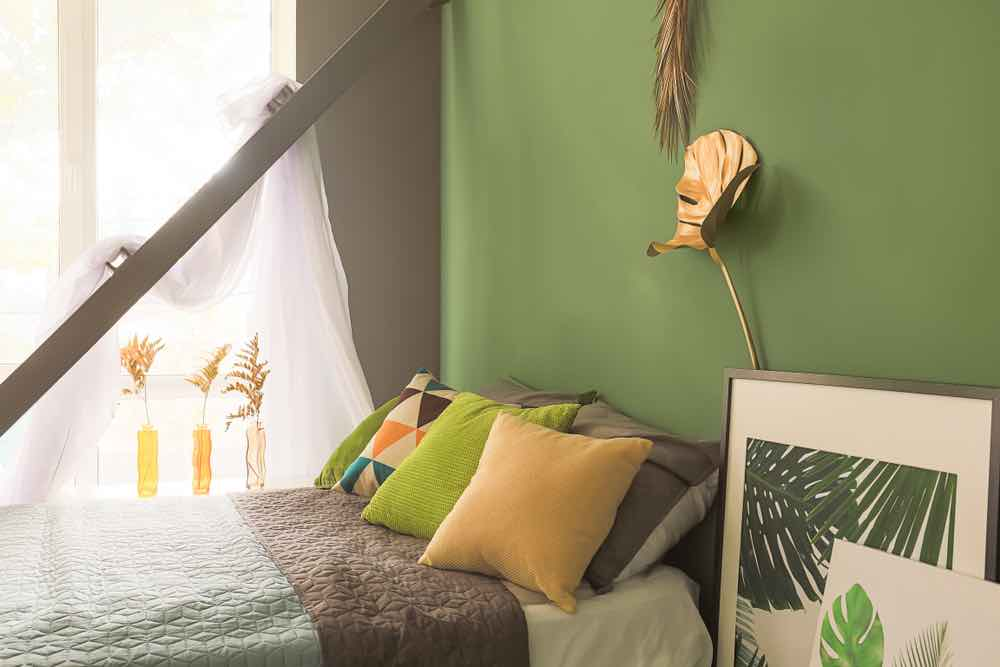Olive green will always be one of the best bedroom paint colors you can pick.