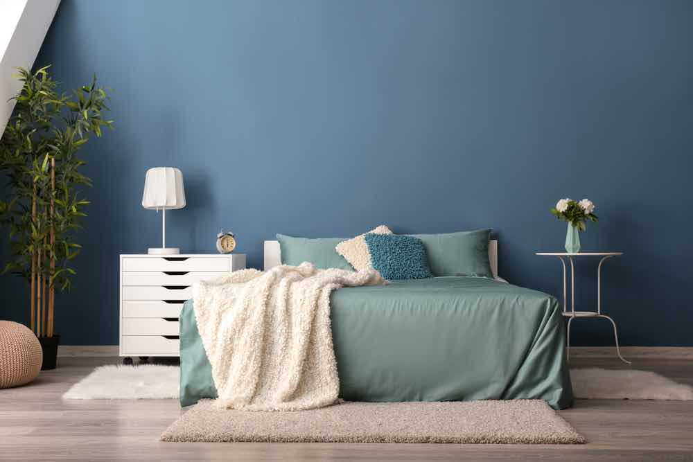 Neutral ocean blue will look great for years to come as a bedroom paint color.