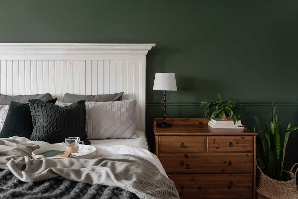 Feel like you're waking up in the English countryside with one of the best bedroom paint colors, forest green.