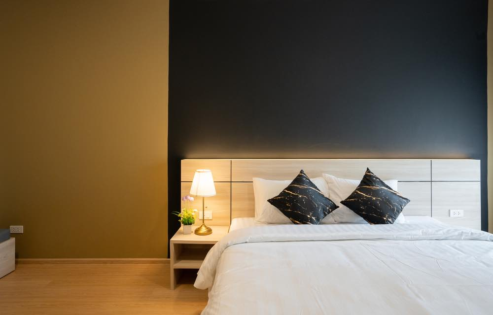 Black isn't just for goths anymore, as this black and gold bedroom proves.
