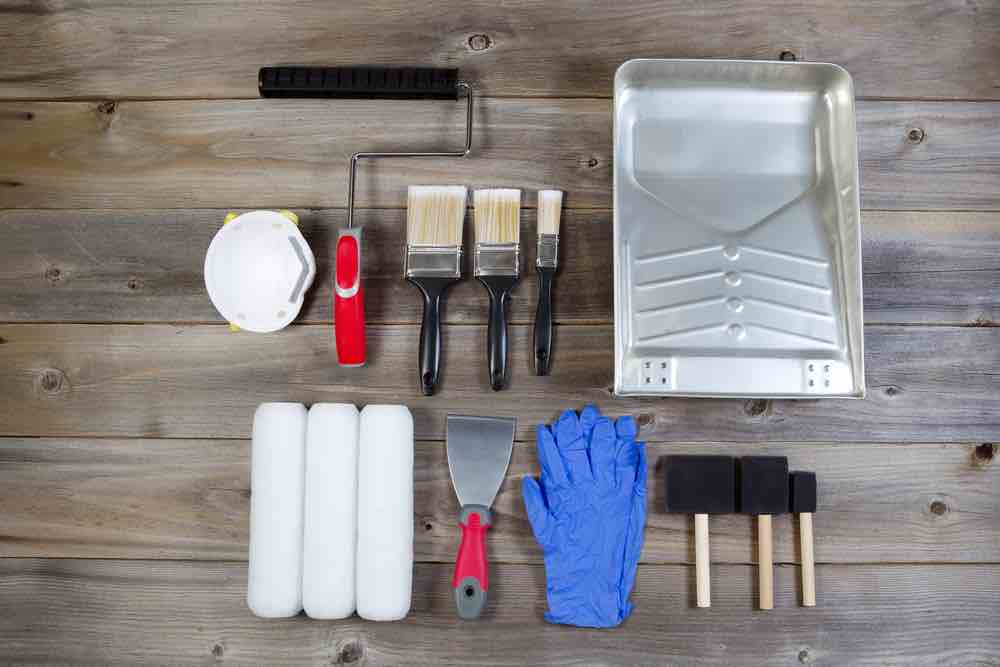 Make sure you have the right gear to do the job before starting your DIY garage painting job.