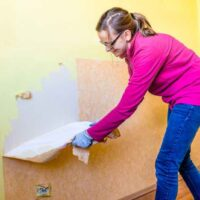 Woman Removing Wallpaper: How To Remove Wallpaper
