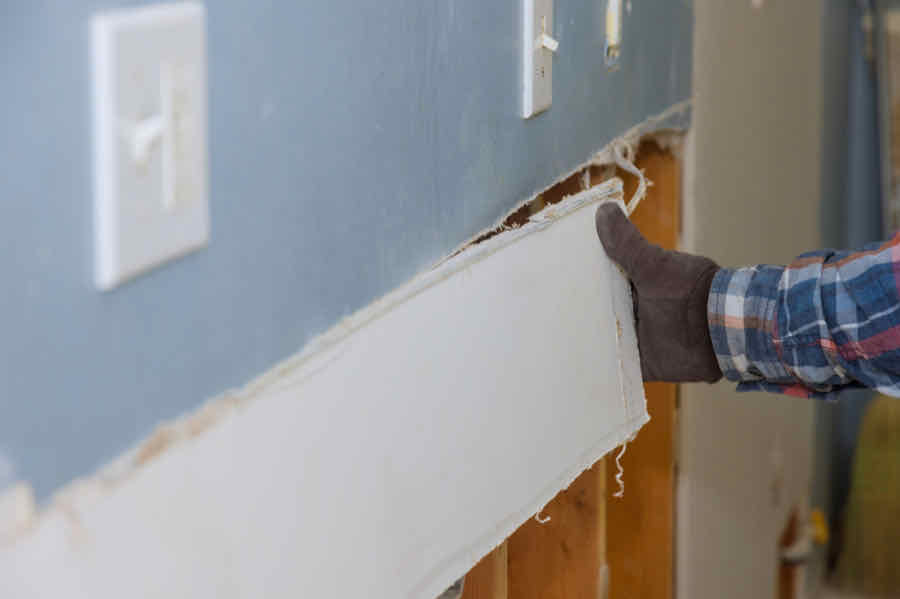 removing a piece of drywall from a wall