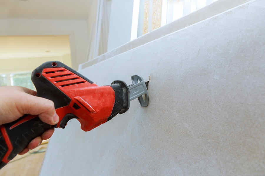 cutting drywall with a drywall router