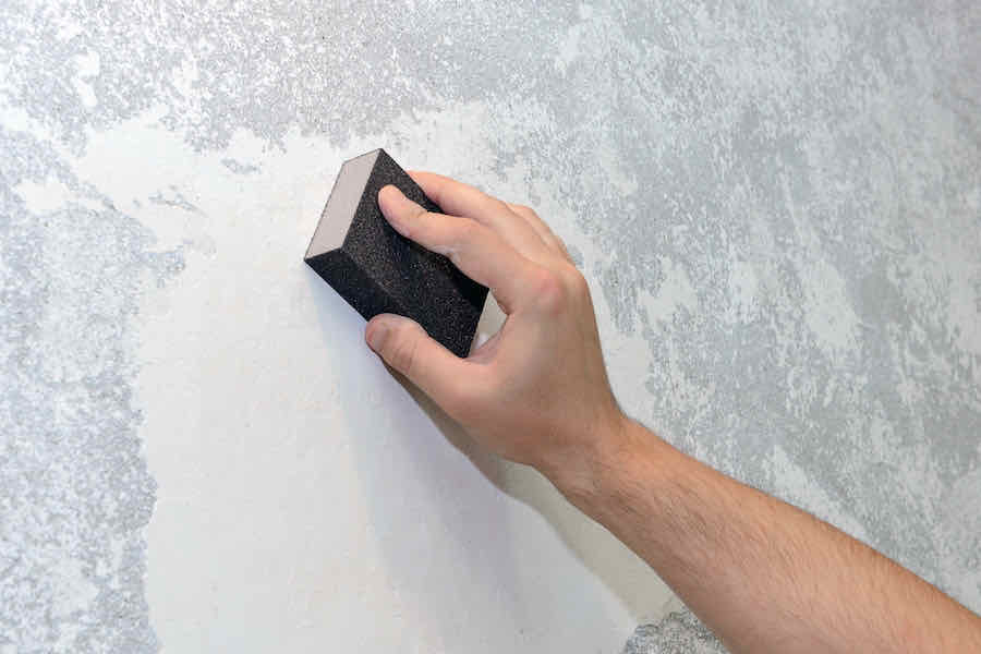 working sanding drywall mud
